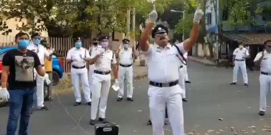 Kolkata police sing 'We shall overcome' amid coronavirus lockdown.