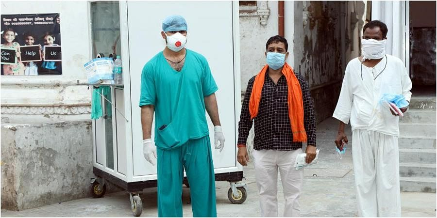 Three COVID-19 patients fully recovered and discharged from King George's Medical University, in Lucknow