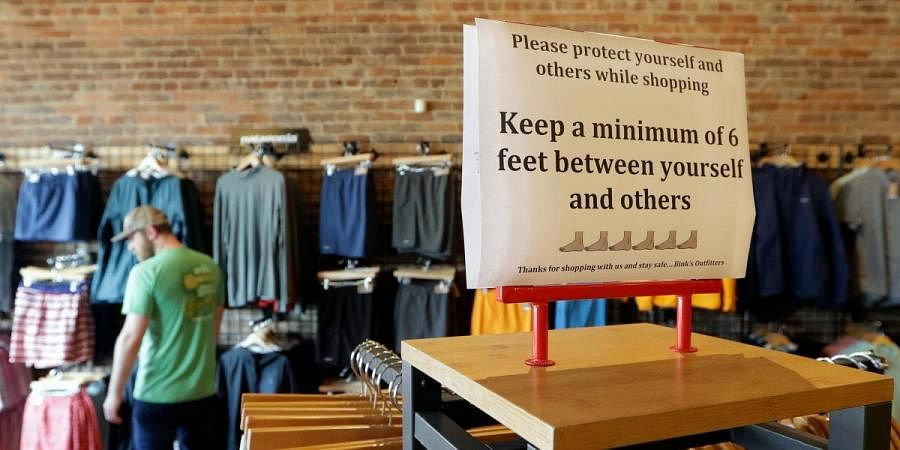 A sign reminding customers of social distancing is posted in the Bink's Outfitters store in Murfreesboro, Tennessee