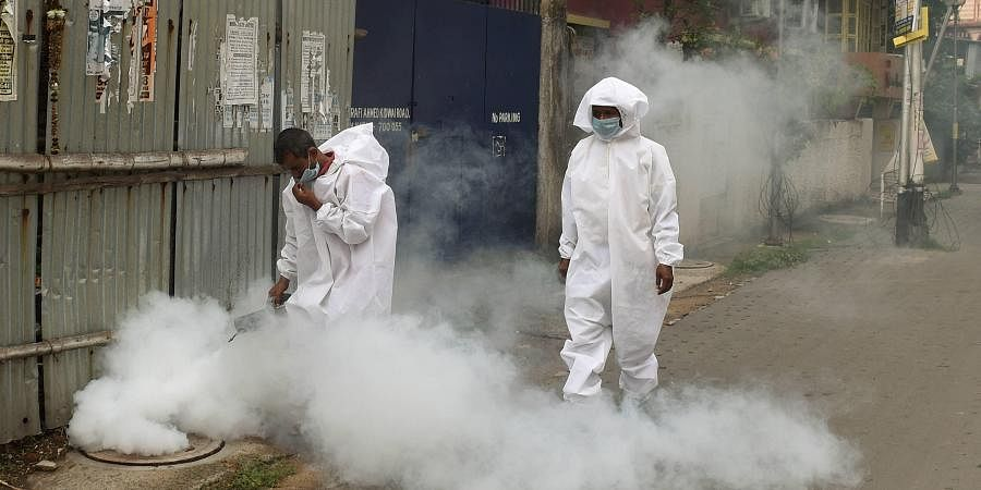 Municipal corporation workers fumigate in a locality amid concerns over COVID-19 outbreak during ongoing nationwide lockdown in Kolkata Tuesday April 28 2020. (Photo | PTI)