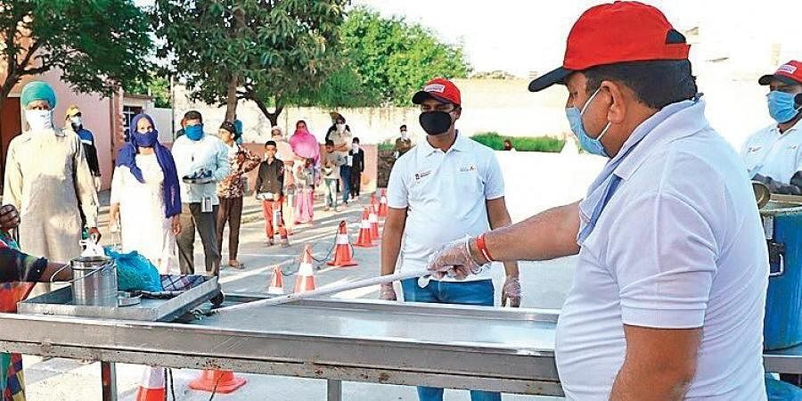 Volunteers at Chandigarh University with a a special serving trolley.