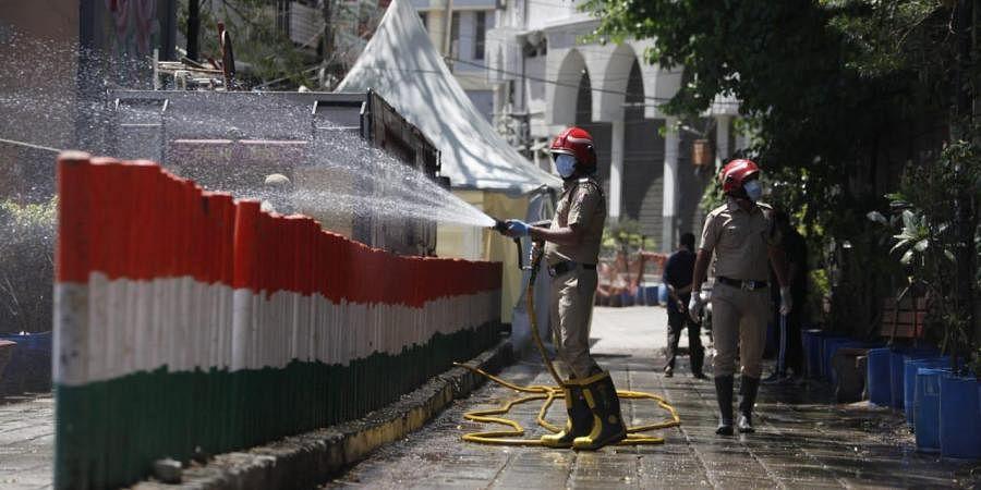Delhi fire service staff sanitize the Nizamuddin area in New Delhi on Friday.