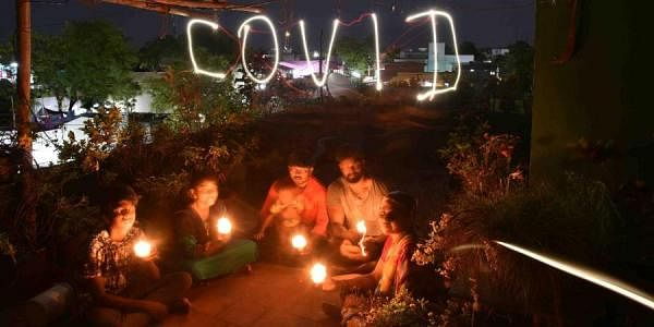 Following the clarion call by PM Narendra Modi to light lamps to cheer up the nation while under coronavirus lockdown, a family lights the lamp at Tuticorin. (Photo | V Karthikalagu, EPS)