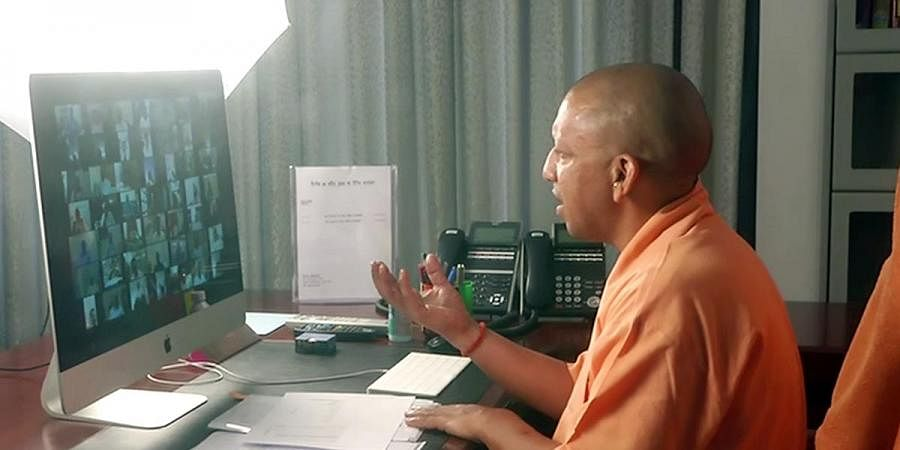 Uttar Pradesh CM Yogi Adityanath interacts with district officials on COVID-19 arrangements through video conferencing, in Lucknow