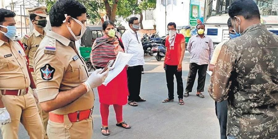 Police personnel hold an awareness drive on covid-at Bhavanipuram on Saturday