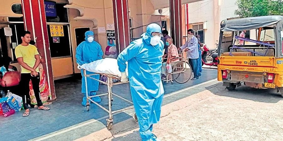 The body of a 65-year-old man being shifted to mortuary in Kakinada on  Saturday (Photo | EPS)