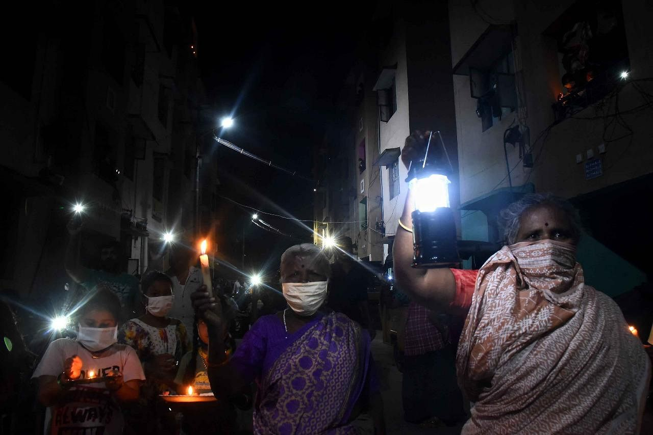 Residents of Kamarajar Nagar near R.S Puram in Coimbatore were seen with lamp, candle and torch light to show their solidarity against coronavirus as requested by Prime Minister Narendra Modi on Sunday for 9 minutes
