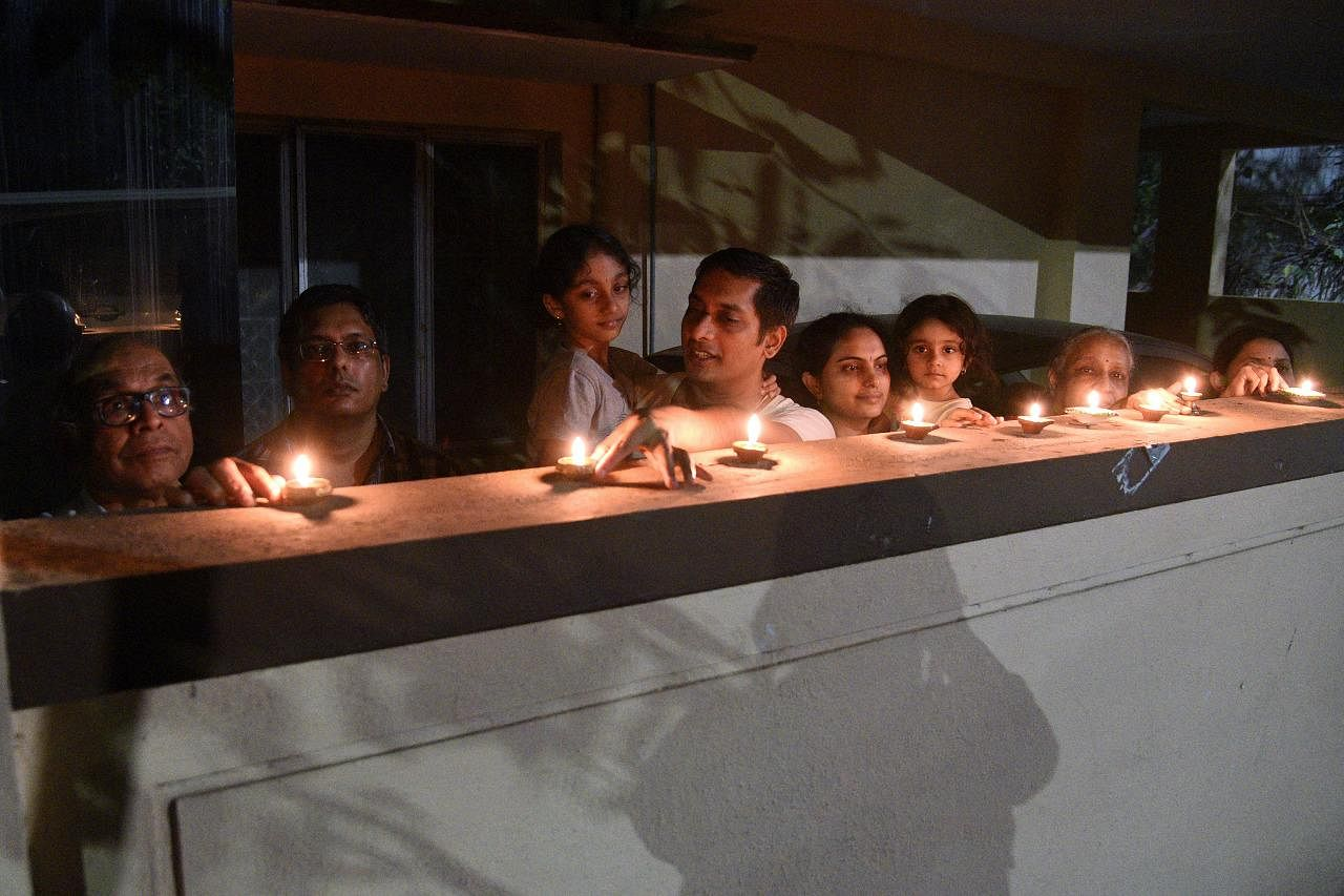 People switched off non essential lights and lit diyas and candles in their balconies and verandas on Sunday night following a call this week from Prime Minister Narendra Modi to express unity in their fight against the Coronavirus Crisis, in Bengaluru on Sunday.