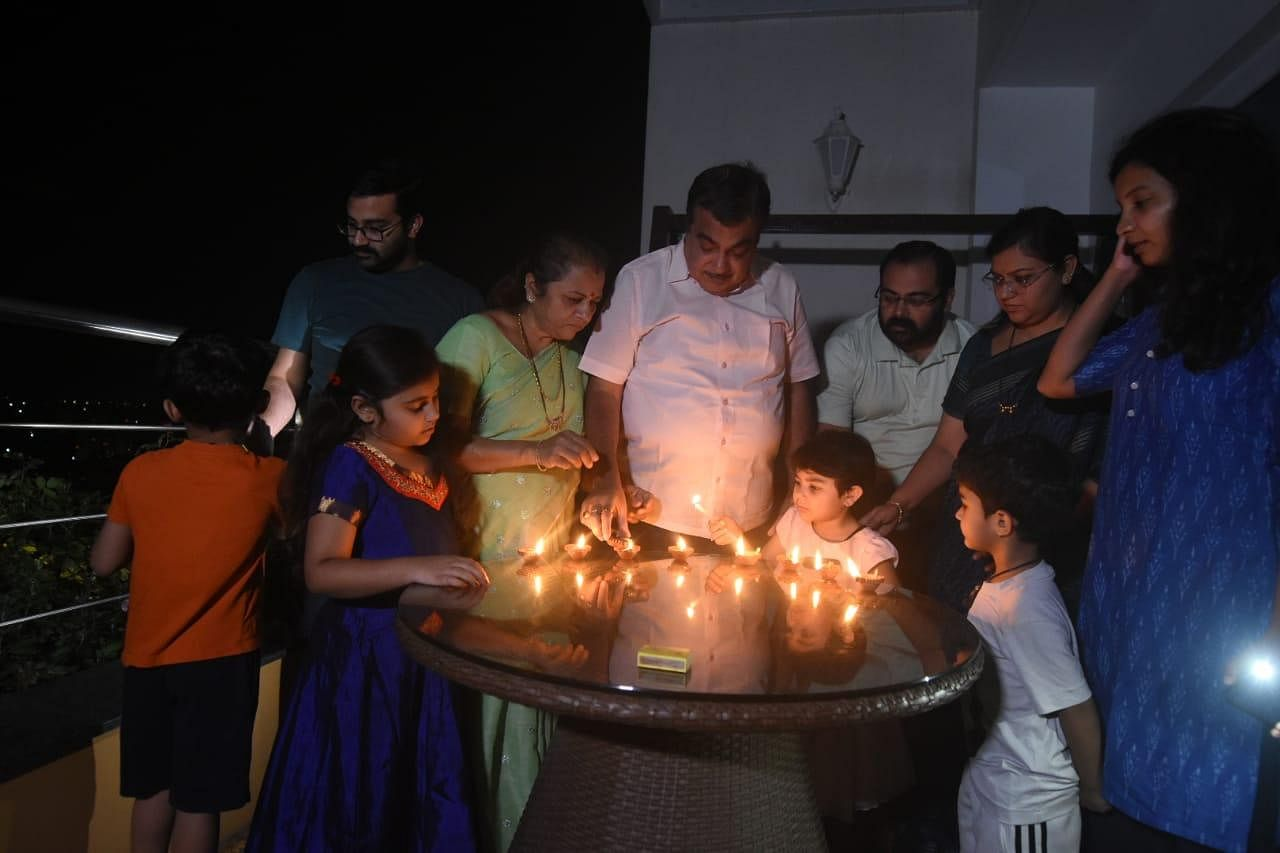 Union minister Nitin Gadkari with his family members lit diyas and candles at his residence in New Delhi in order to express solidarity with Prime Minister Narendra Modi's appeal to the nation to observe a nine minute blackout.