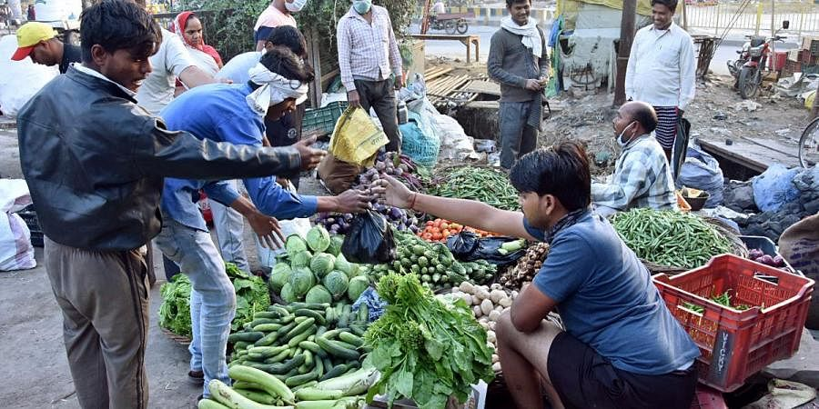 People buying vegetables from market during a nationwide lockdown in wake of coronavirus pandemic, in Mathura