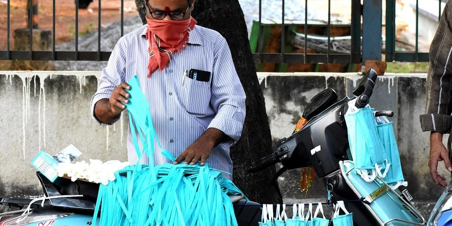 Roadside vendor selling each face mask cost of Rs.50 in Tirupati.