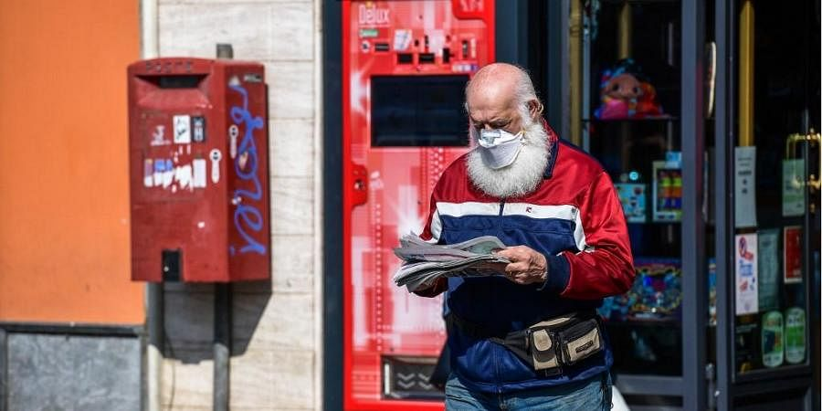 Man wears a mask to protect himself from coronavirus. (Photo| AFP)