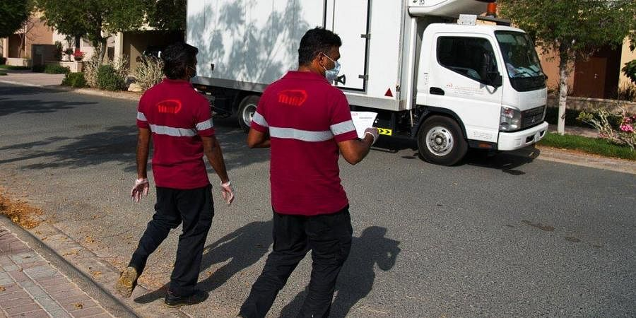 Deliverymen leave after dropping off alcohol at a home in Dubai, United Arab Emirates.