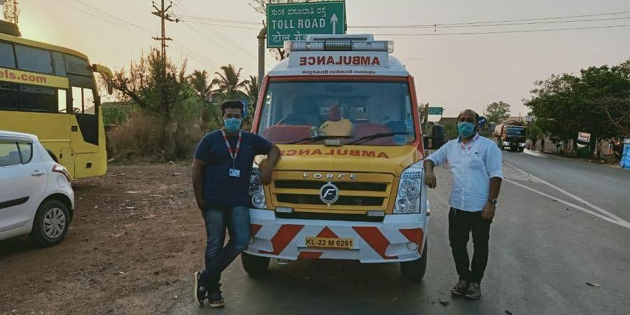 108 ambulance pilot Harshith Kumar and nurse Justine at Thalappady. The vehicle ferries patients to Mangaluru