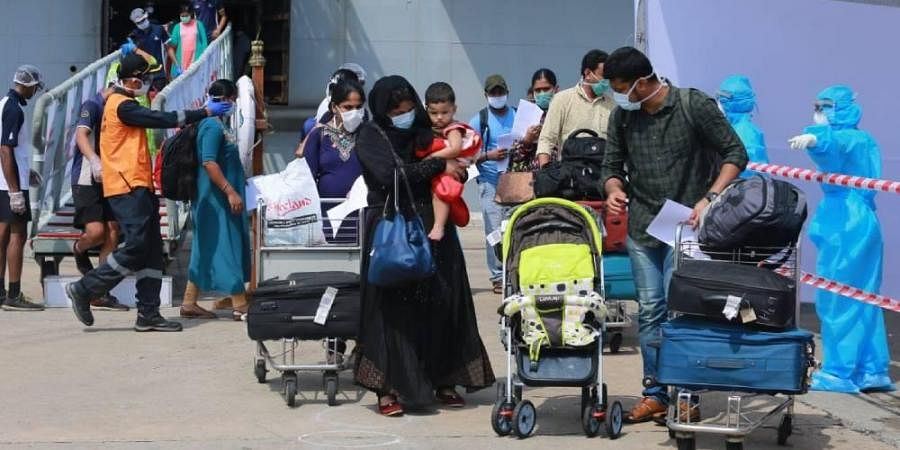 Passengers deboarding INS Jalashwa which carried 698 Indians from Maldieves under Operation Samudra Sethu.