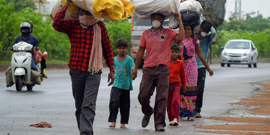 Migrant workers of Madhya Pradesh walking back home from Bhubaneswar on Wednesday