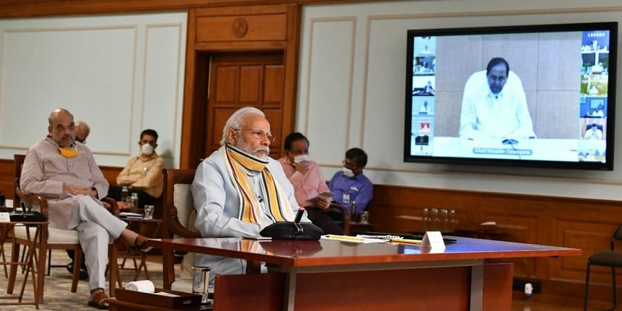 Prime Minister Narendra Modi interacts with the Chief Ministers of various States via video conferencing to discuss COVID-19 situation in New Delhi