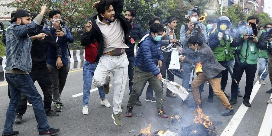 Demonstrators shout slogans and burn an effigies during a protest against India's newly inaugurated link road to the Chinese border. (Photo  AFP)