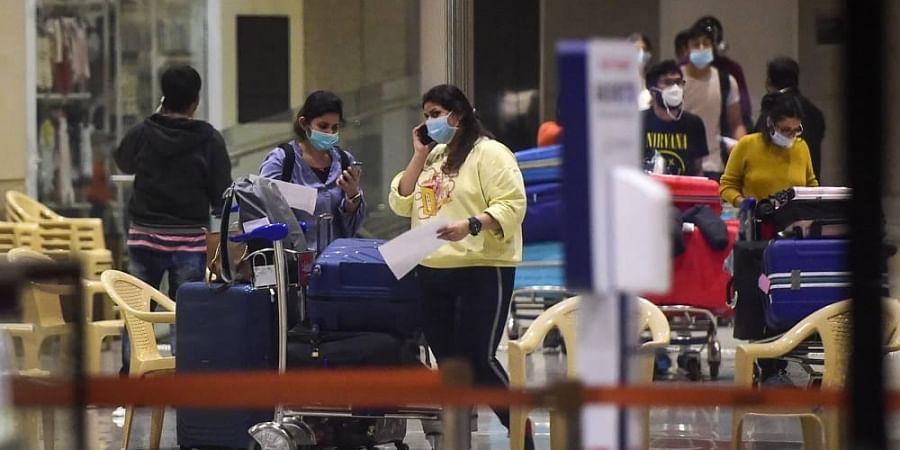 Indian nationals stranded in UK arrive at Chatrapati Shivaji Maharaj International airport during the ongoing COVID-19 nationwide lockdown in Mumbai on Sunday.