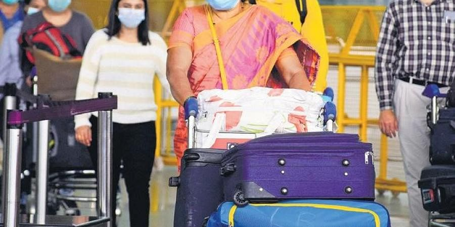 The first batch of people repatriated to India from London arrive at Kempegowda International Airport early on Monday.