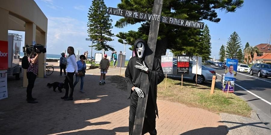 A man dressed as Grim Reaper. (Photo| AFP)