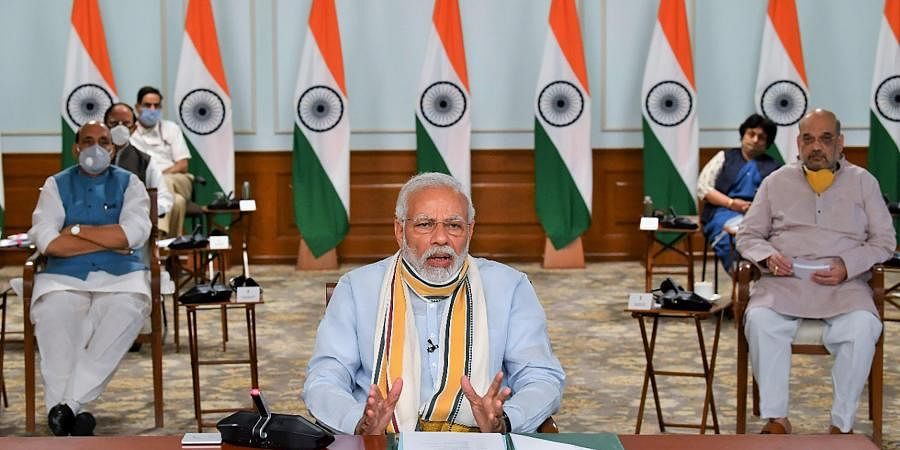 Prime Minister Narendra Modi interacts with the Chief Ministers of various States via video conferencing to discuss COVID-19 situation in New Delhi Monday May 11 2020.