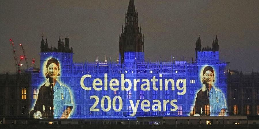 An image of Florence Nightingale is projected on the Houses of Parliament in Westminster, London. (Photo | AP)