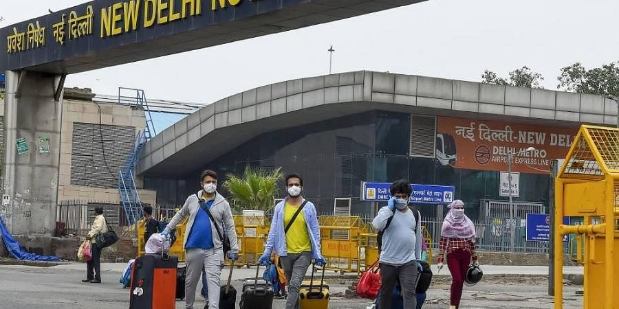 Passengers arrive at New Delhi Railway station following the resumption of passenger train services by Indian Railways connecting major cities during the ongoing COVID-19 nationwide lockdown in New Delhi