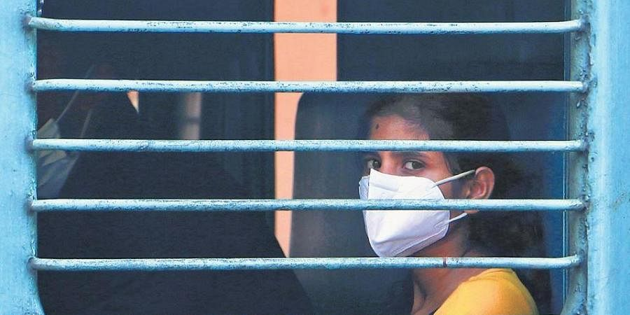 In the wake of the coronavirus outbreak, train travellers take precautionary measures such as protective masks.