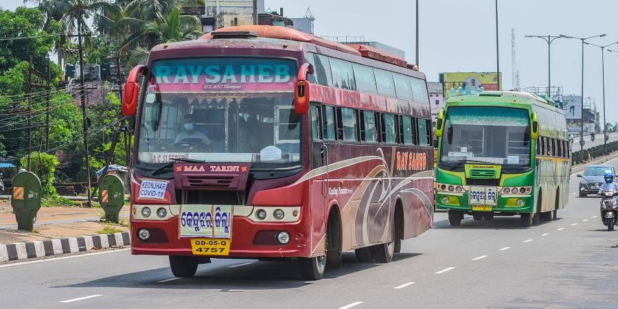 Buses carrying migrant labourers from Khordha Road Railway Station to their respective destination in Bhubaneswar on Monday.
