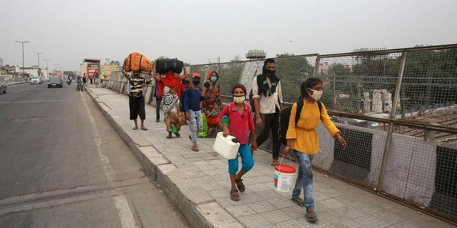 Migrant workers on their way to home during the nationwide COVID-19 lockdown in New Delhi
