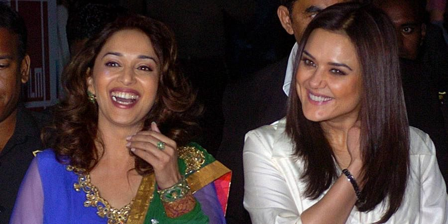 Bollywood actors Madhuri Dixit and Preity Zinta at the premiere of Slumdog Millionaire in Mumbai.