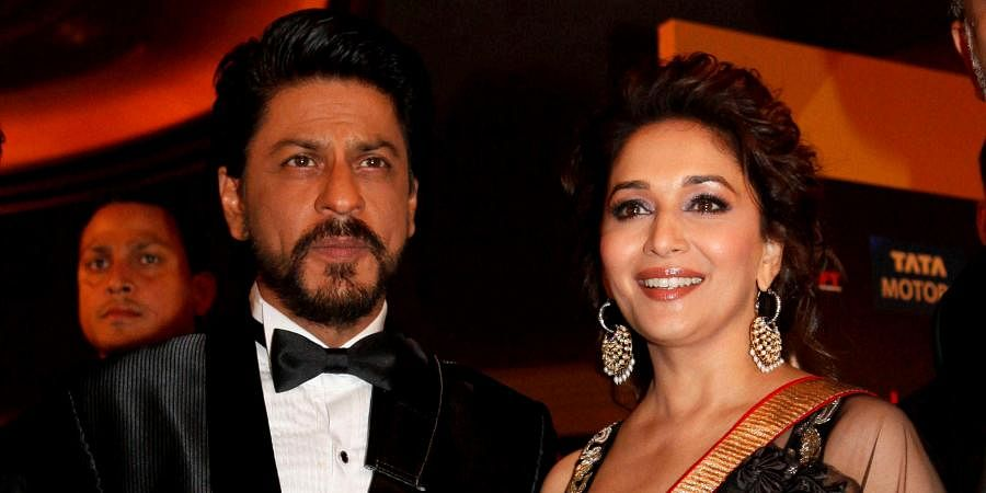 Bollywood actors Shah Rukh Khan and Madhuri Dixit arrive for the International Indian Film Academy awards.