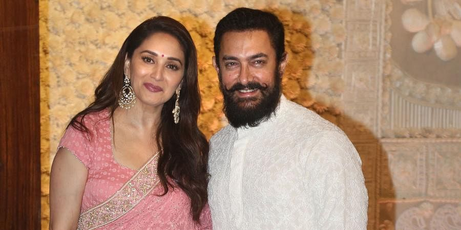 Bollywood actors Aamir Khan and Madhuri Dixit arrive for 'Ganesh Chaturthi' celebrations at Reliance Industries Chairman Mukesh Ambani's residence 'Antilla' in Mumbai.