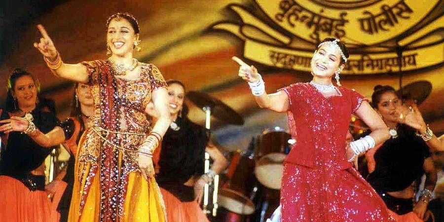 Bollywood actors Madhuri Dixit and Amisha Patel rendering a dance performance at a Diwali function organised by Mumbai Police.