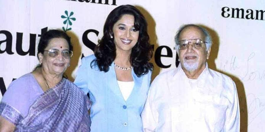 Bollywood actress Madhuri Dixit with her parents at a function in Kolkata.