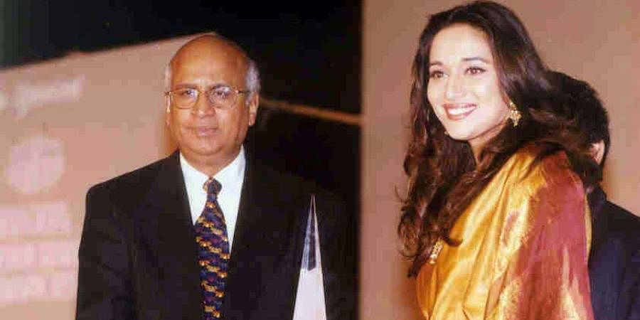 Bollywood actress Madhuri Dixit  receiving award of Indo-American Society from S Ramadurai, president of the society at a function in Mumbai.