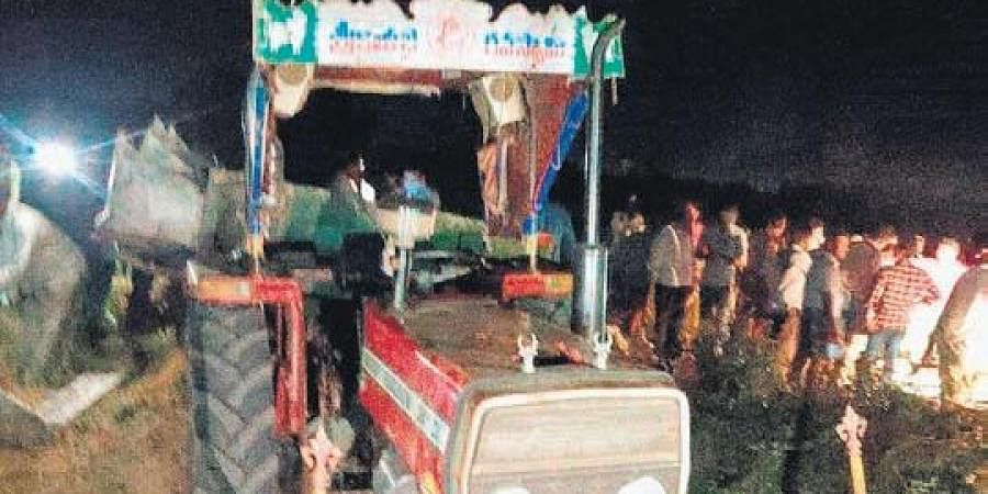 High-tension electric wires snap and fall on a tractor carrying agriculture labourers, at Machavaram village in Prakasam district on Thursday