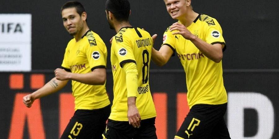 Haaland stars as Dortmund rout Schalke 4-0 on return of football ...
