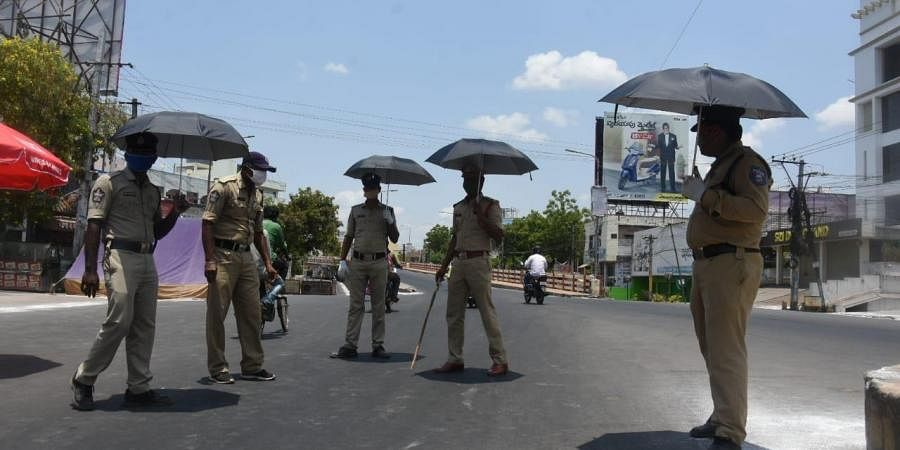 Police personnel at a check point. (Photo| EPS/ P Ravindra Babu)