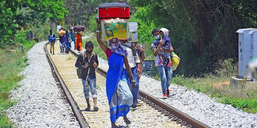 Migrant workers walk along a railway track from Bengaluru to Chhattisgarh, near Nandi Hills in Chikkaballapur