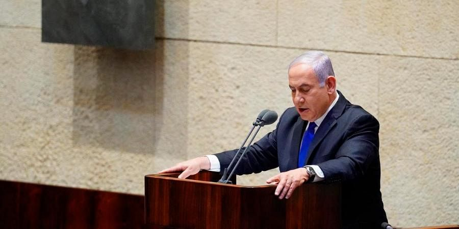 Israel PM Benjamin Netanyahu speaks during a swearing in ceremony of his new unity government with election rival Benny Gantz, at the Knesset