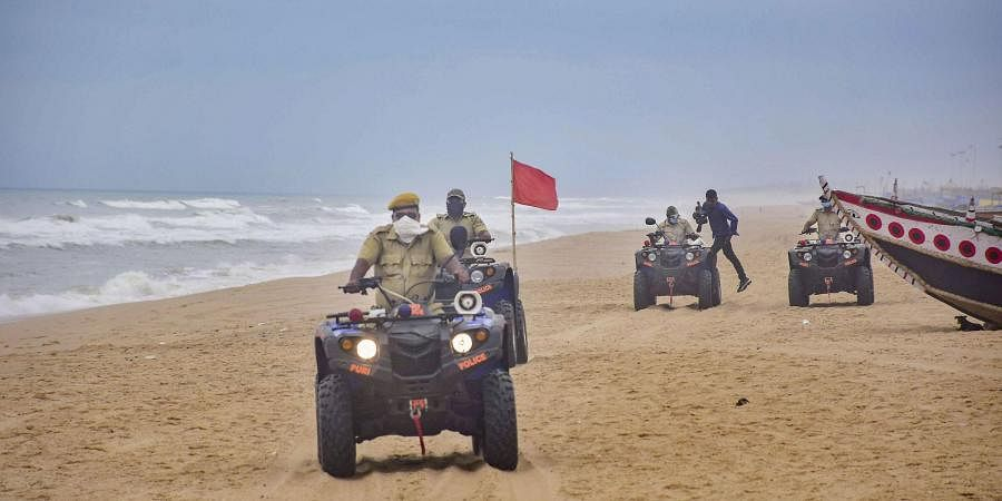 Marine police personnel patrol Puri beach to prevent tourists and fishermen from venturing into the sea due to Cyclone Amphan in Puri. (Photo   PTI)