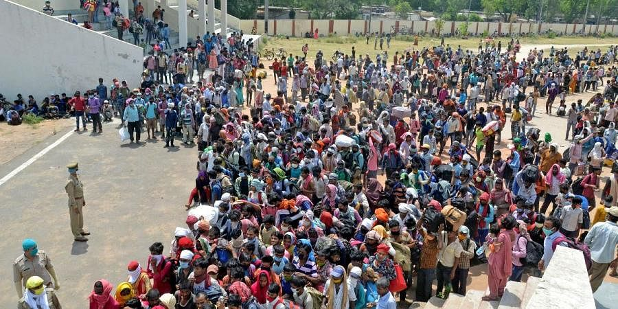 A large number of migrant workers gather at Govardhan Stadium in Agra on Monday