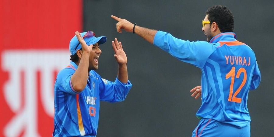 Indian cricketer Rohit Sharma (L) with Yuvraj Singh. (Photo | AFP)