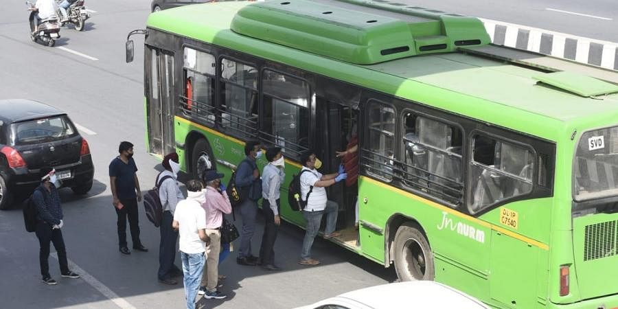 Office workers board DTC buses at Akshardham as the Delhi Government resumed bus services within the city on Tuesday