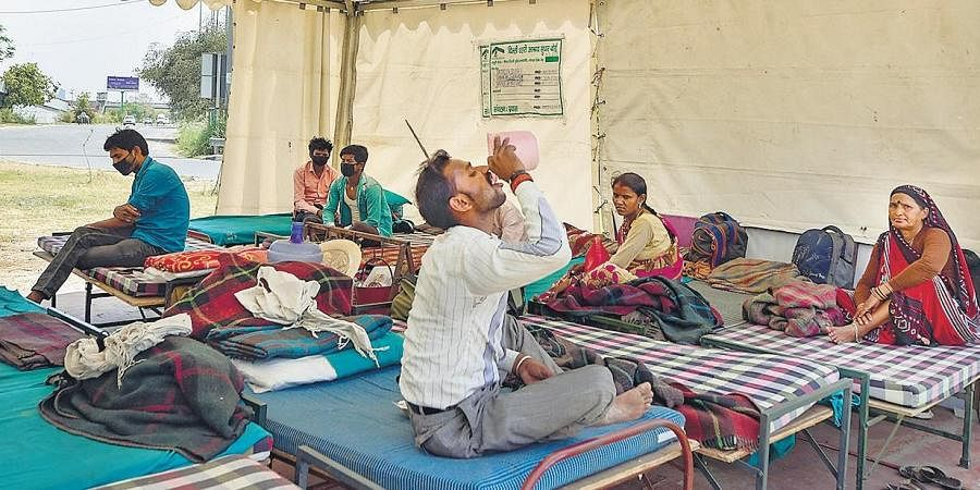 Migrant workers take refuge in a temporary Delhi Government-run shelter home