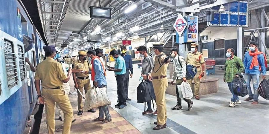 Migrant labourers boarding the special train arranged by the Telangana government to send them back to their native places in Jharkhand, at Lingampally railway station in Hyderabad on Friday