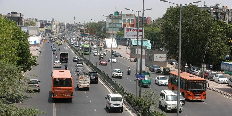 Vehicles move at Ring road after the relaxation in lockdown norms in New Delhi