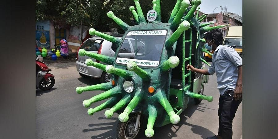 An auto shaped like coronavirus on its way to disinfect the Ka Ka Thope Braodway on Wednesday in Chennai.